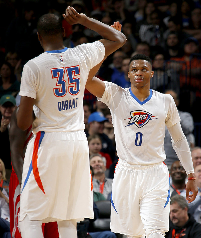Photo - Oklahoma City's Russell Westbrook (0) and Kevin Durant (35) celebrate during an NBA basketball game between the Oklahoma City Thunder and the Houston Rockets at Chesapeake Energy Arena in Oklahoma City, Tuesday, March 22, 2016. Oklahoma City won 111-107. Photo by Bryan Terry, The Oklahoman