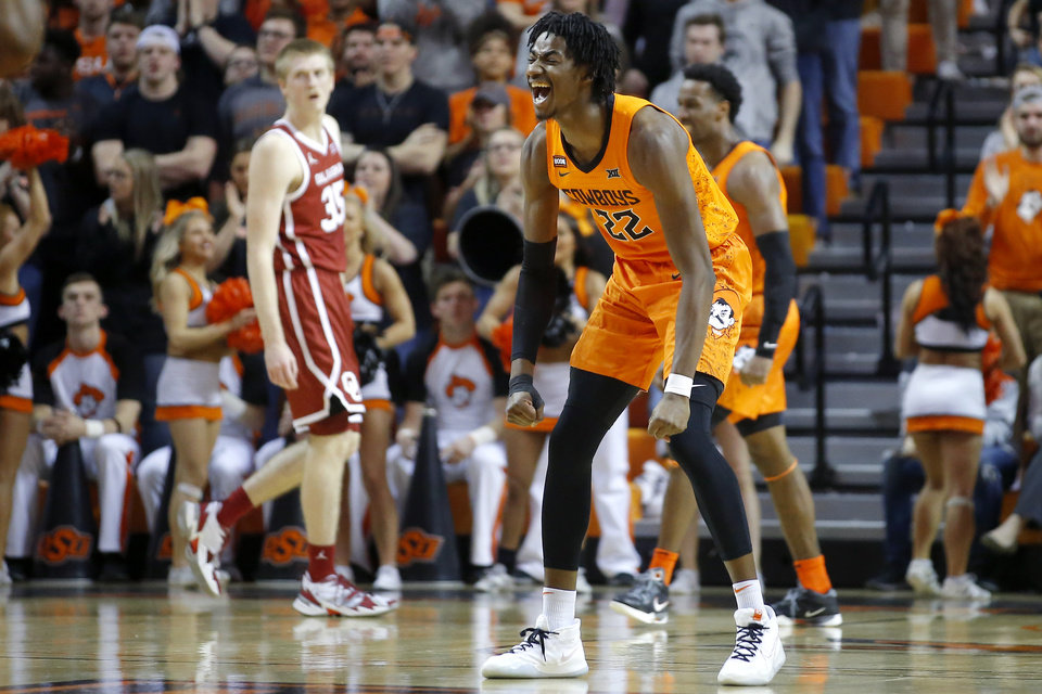 Photo - Oklahoma State's Kalib Boone (22) celebraates during an NCAA men's Bedlam basketball game between the Oklahoma State University Cowboys (OSU) and the University of Oklahoma Sooners (OU) at Gallagher-Iba Arena in Stillwater, Okla., Saturday, Feb. 22, 2020. Oklahoma State won 83-66. [Bryan Terry/The Oklahoman]