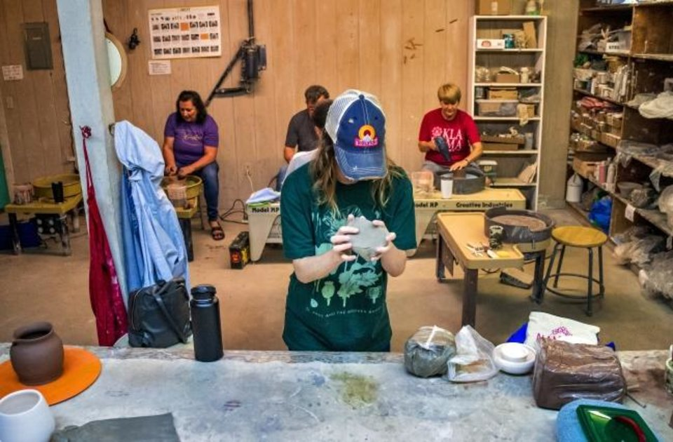 Photo -  Student Haley Wilson works with clay in Taylor Dickerson's pottery class.   [Chris Landsberger/The Oklahoman]