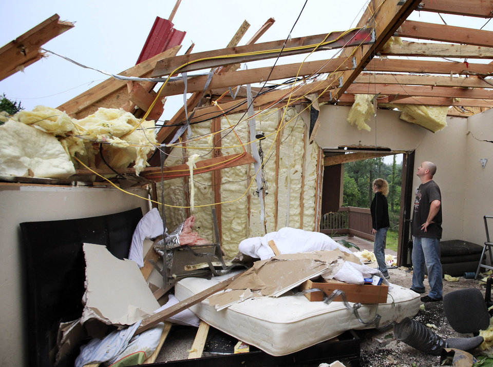 Photo - David Potts and Dava Hight inspect the home of Miles and Rachel Maynor Tuesday morning, May 11, 2010.  The home was destroyed in Monday night's tornado.  Photo by Jim Beckel, The Oklahoman.