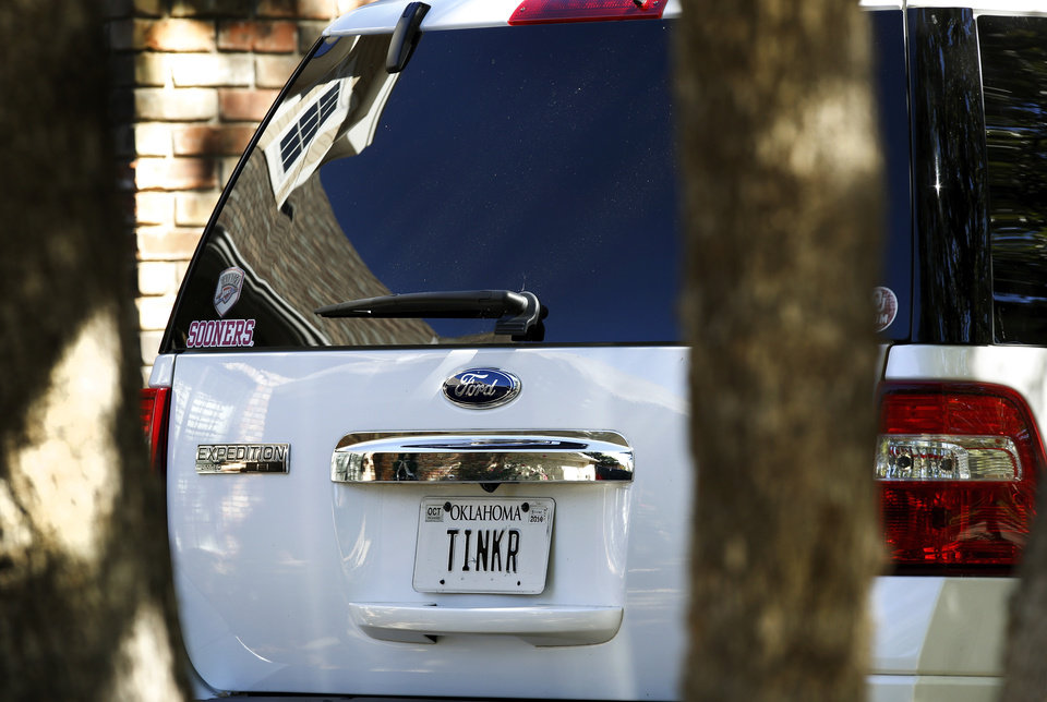 Photo - An SUV with personalized license plates is one of three vehicles parked in the driveway at 1217 Bent Tree Street on Tuesday, Oct. 14, 2014.  The residents of the southwest Oklahoma town of Duncan are stunned to learn of the discovery of three members of a prominent Duncan family in their home, victims of a triple homicide in an upscale neighborhood on the north side of town Monday morning,  Oct. 13, 2014.  John and Tinker Hruby and their daughter, Katherine,  17, were found dead by the family's housekeeper.    Photo by Jim Beckel, The Oklahoman