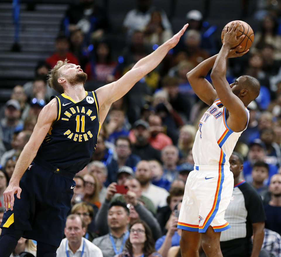 Photo - Oklahoma City's Chris Paul (3) shoots against Indiana's Domantas Sabonis (11) in the fourth quarter during an NBA basketball game between the Indiana Pacers and the Oklahoma City Thunder at Chesapeake Energy Arena in Oklahoma City, Wednesday, Dec. 4, 2019. Indiana won 107-100. [Nate Billings/The Oklahoman]