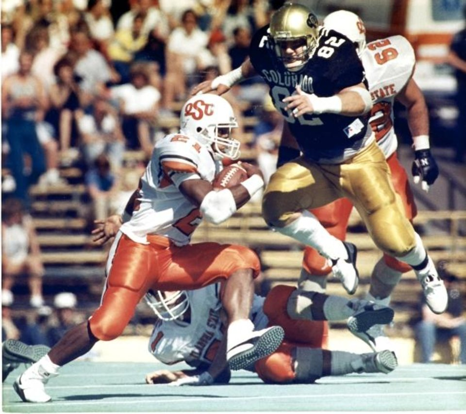 Photo -  Spoiler alert: Colorado's Cole Hayes, or seemingly anyone else in 1988, could stop OSU's Barry Sanders. [OKLAHOMAN ARCHIVES]