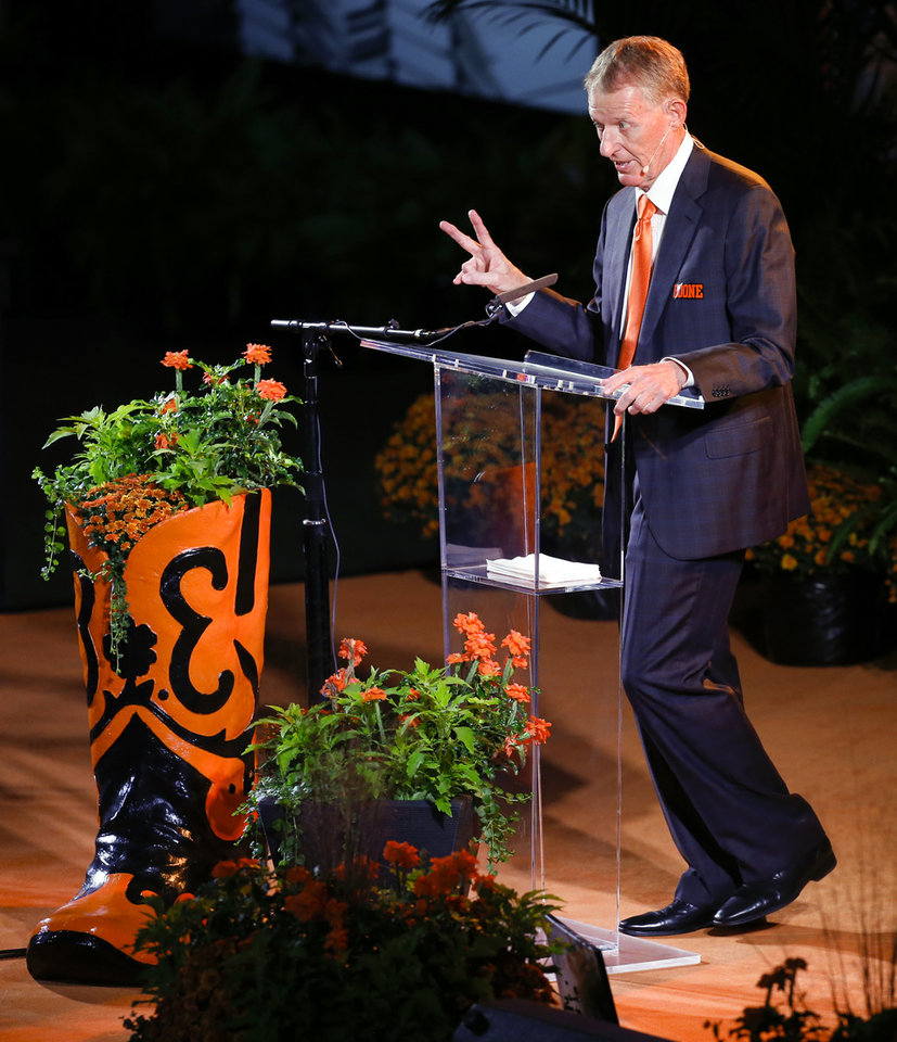 Photo - Oklahoma State athletic director Mike Holder speaks during the Celebration of Life for OSU alumnus and benefactor Boone Pickens at Gallagher-Iba Arena in Stillwater, Okla., Wednesday, Sept. 25, 2019. [Nate Billings/The Oklahoman]