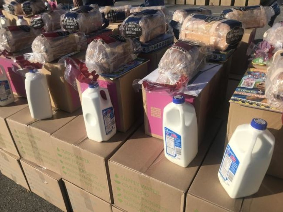 Photo -  Food, including milk and bread from Braum's, await families during the