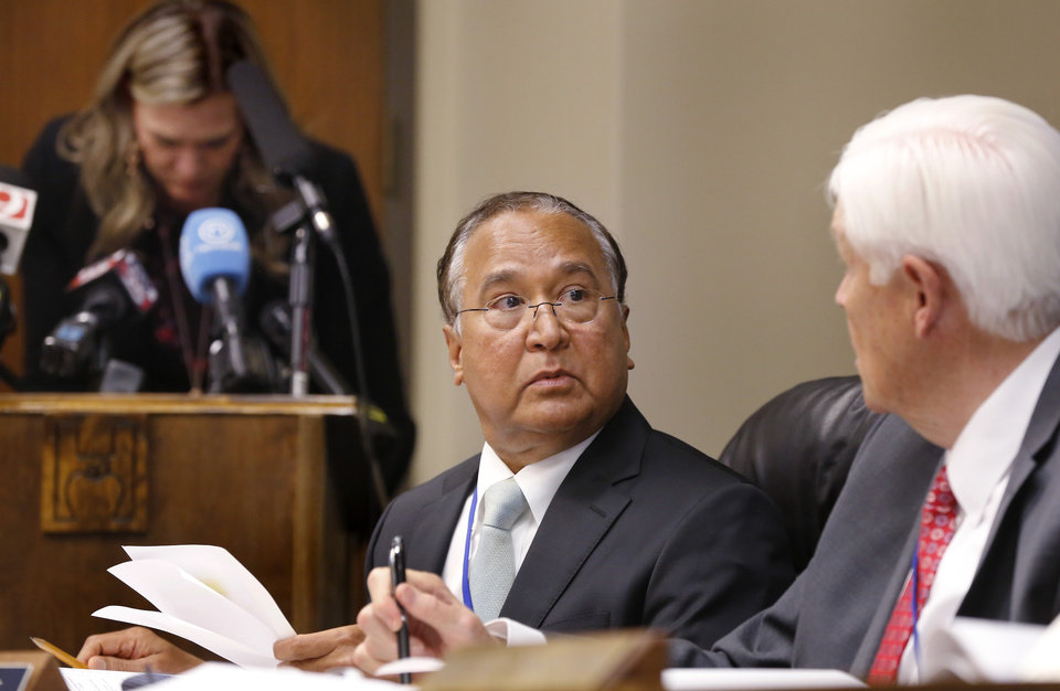 Photo - R. Murai Krishna, left, and Ronald Osterhout. The Oklahoma State Department of Health voted at their monthly meeting Tuesday morning, July 10, 2018, to ban sales of smokeable forms of medical marijuana and to require dispensaries to hire a pharmacist. The Board of Health voted on 75 pages of rules creating a rough framework for patients, physicians, caretakers and business owners interested in medical marijuana. The ban on sales of leaves and flowers for smoking and the requirement to hire a pharmacist weren't in the draft rules presented to the board, but were a priority of a coalition of medical groups. Julie Ezell, the Health Department's general counsel, presented the rules to a packed board room and to members of the public watching in an overflow room and online. She cautioned board members that the two new rules they added might not be allowed under the state question, inviting a court challenge. Photo by Jim Beckel, The Oklahoman