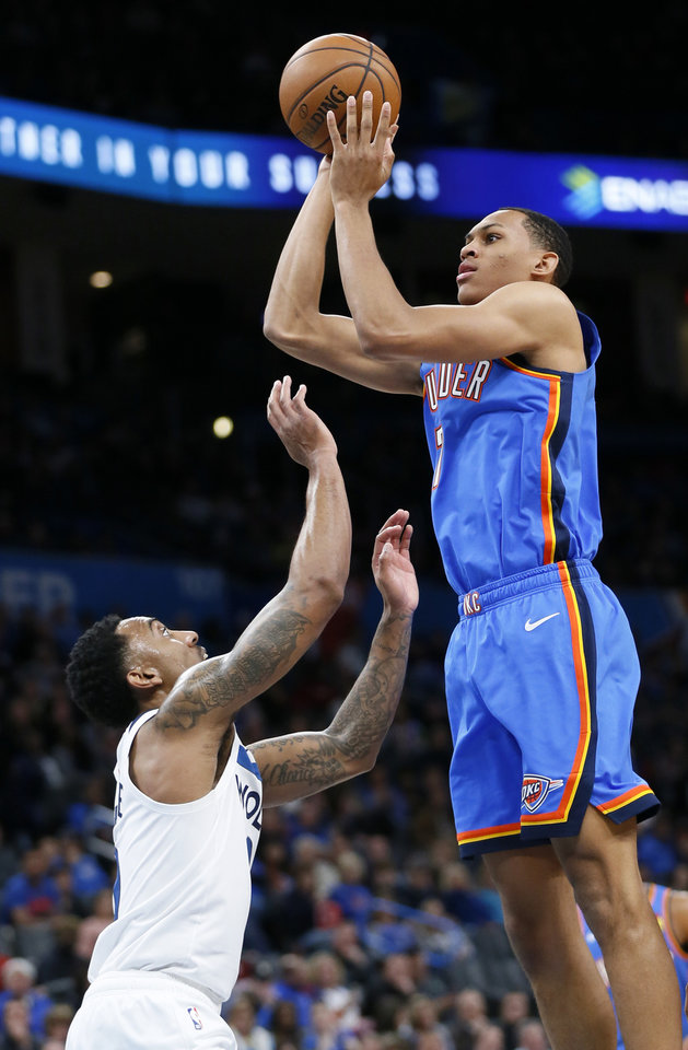 Photo - Oklahoma City's Darius Bazley (7) shoots over Minnesota's Jeff Teague (0) during an NBA basketball game between the Minnesota Timberwolves and the Oklahoma City Thunder at Chesapeake Energy Arena in Oklahoma City, Friday, Dec. 6, 2019. [Nate Billings/The Oklahoman]