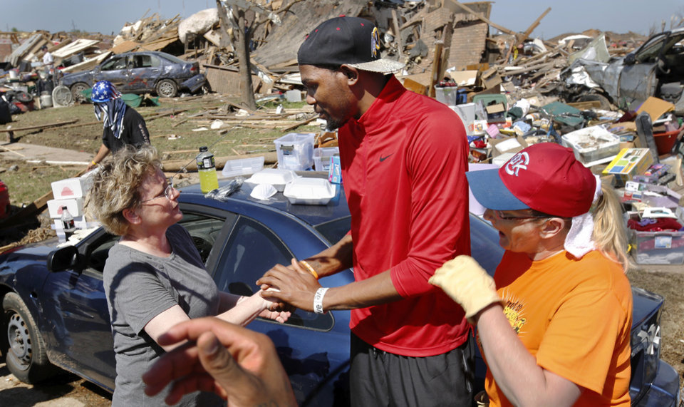 Photo - Oklahoma City Thunder's Kevin Durant toured a southwest Oklahoma City neighborhood that took a direct hit in last Monday's F5 tornado to offer words of support and encouragement to homeowners and volunteers assisting with the relief effort. Durant walked several blocks along S Hudson, near SW 145, on Wednesday afternoon, May 22, 2013, and also visited Briarwood School, the heavily damaged elementary school in the same neighborhood.     Photo  by Jim Beckel, The Oklahoman.