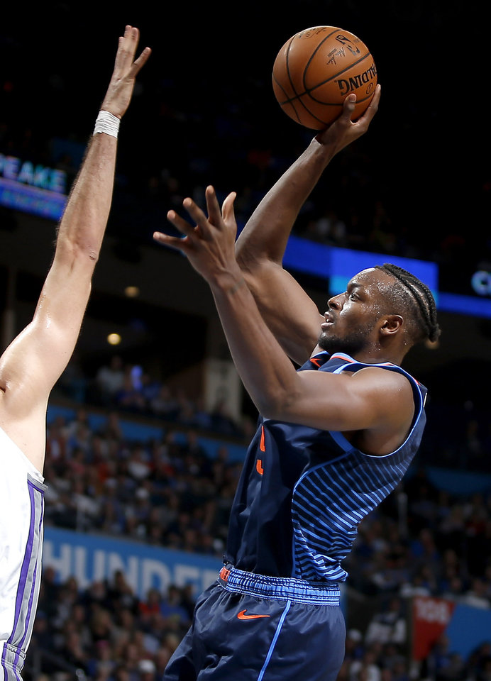 Photo - Oklahoma City's Jerami Grant (9) shoots during an NBA basketball game between the Oklahoma City Thunder and the Sacramento Kings at Chesapeake Energy Arena in Oklahoma City, Sunday, Oct. 21, 2018. Photo by Bryan Terry, The Oklahoman