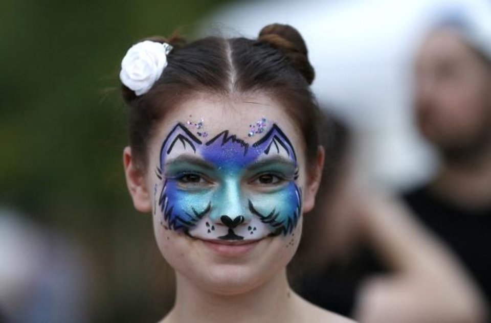 Photo -  Leah Preslar smiles after getting her face painted during the 2018 Cat Video Festival at the Myriad Botanical Gardens in Oklahoma City. [Sarah Phipps/The Oklahoman Archives]