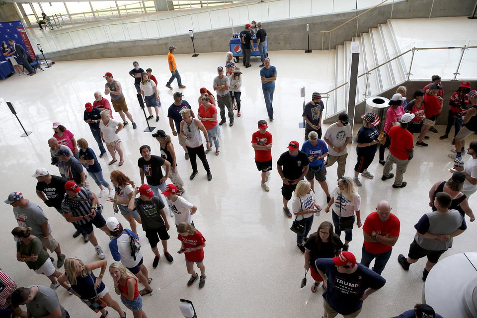 Photo - People wait in line the President Donald Trump a rally at the BOK in Tulsa, Okla., Saturday, June 20, 2020. [Sarah Phipps/The Oklahoman]