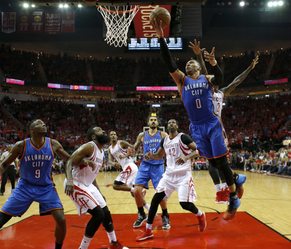 Photo - Oklahoma City's Russell Westbrook (0) goes to the basket as Houston's Patrick Beverley (2) defends during Game 2 in the first round of the NBA playoffs between the Oklahoma City Thunder and the Houston Rockets in Houston, Texas,  Wednesday, April 19, 2017.  Photo by Sarah Phipps, The Oklahoman