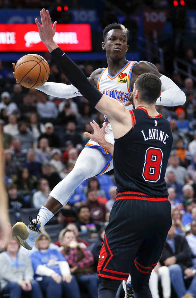 Photo - Oklahoma City's Dennis Schroder (17) passes around Chicago's Zach LaVine (8) in the second quarter during an NBA basketball game between the Oklahoma City Thunder and Chicago Bulls at Chesapeake Energy Arena in Oklahoma City, Monday, Dec. 16, 2019. [Nate Billings/The Oklahoman]