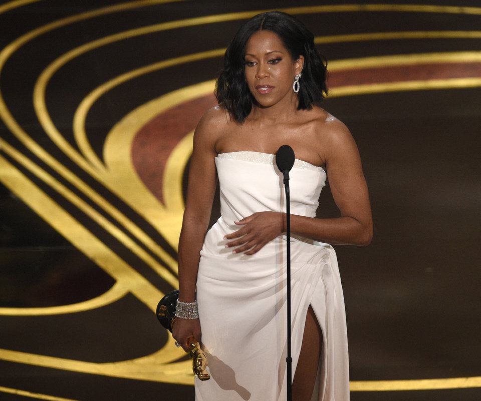 "Photo -  Regina King accepts the award for best performance by an actress in a supporting role for ""If Beale Street Could Talk"" at the Oscars, Sunday in Los Angeles. [Chris Pizzello/Invision via The Associated Press]"