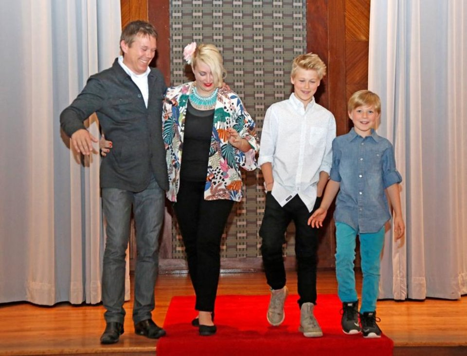 Photo - Alexander Mickelthwate, left, walks down the red carpet Monday with his wife Abigail, sons Jack, 13, and Jacob, 9, at the Civic Center Hall of Mirrors. Mickelthwate was named the Oklahoma City Philharmonic music director designate during a short ceremony. Photo By Steve Gooch, The Oklahoman