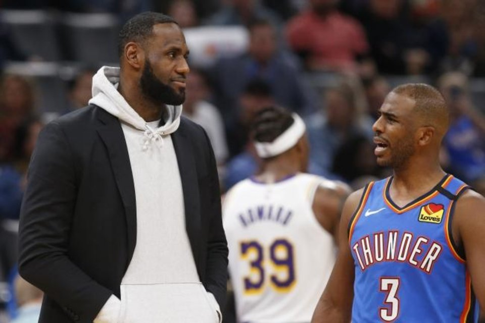 Photo -  Lakers forward LeBron James, left, and Thunder guard Chris Paul (3) were a part of the group of NBA players that received advice from Barack Obama in August on how to play the season while properly drawing attention to the on-going social justice protests happening around America. [AP Photo/Sue Ogrocki]