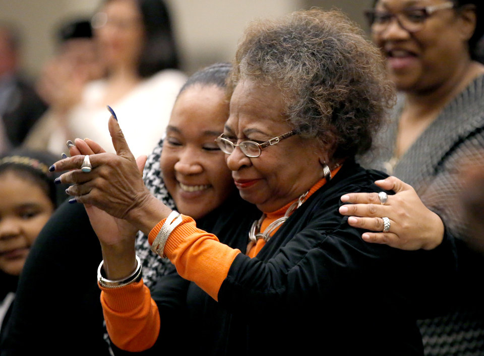 Photo -  Ellishyia Hildreth hugs her mom, Marilyn Hildreth, after the Oklahoma City School Board announced to name the new administration building after Clara Luper at Northeast Academy in Oklahoma City. Marilyn Hildreth's is Clara Luper's daughter.[Photo by Sarah Phipps, The Oklahoman]