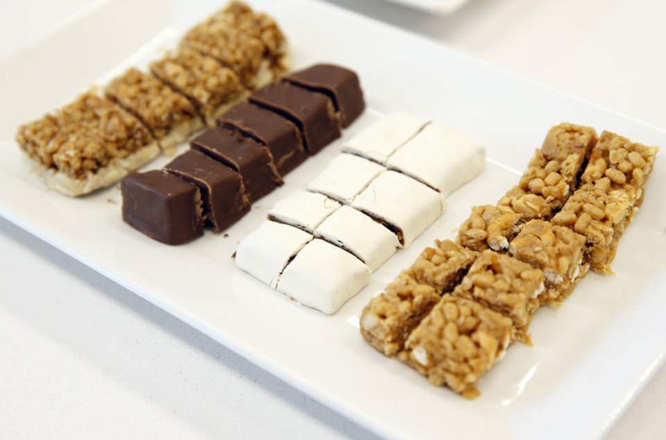 Photo -  From left, samples of cinnamon, mint chocolate, oatmeal raisin and peanut pretzel bars are shown at Profile Sanford in Oklahoma City.
