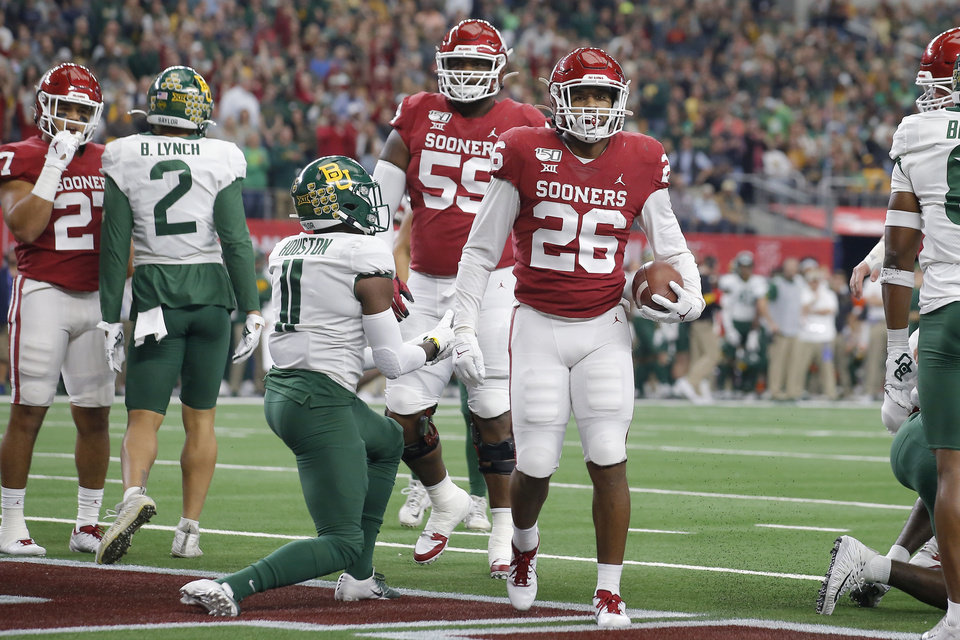 Photo - Oklahoma's Kennedy Brooks (26) scores a touchdown during the Big 12 Championship Game between the University of Oklahoma Sooners (OU) and the Baylor University Bears at AT&T Stadium in Arlington, Texas, Saturday, Dec. 7, 2019. [Bryan Terry/The Oklahoman]