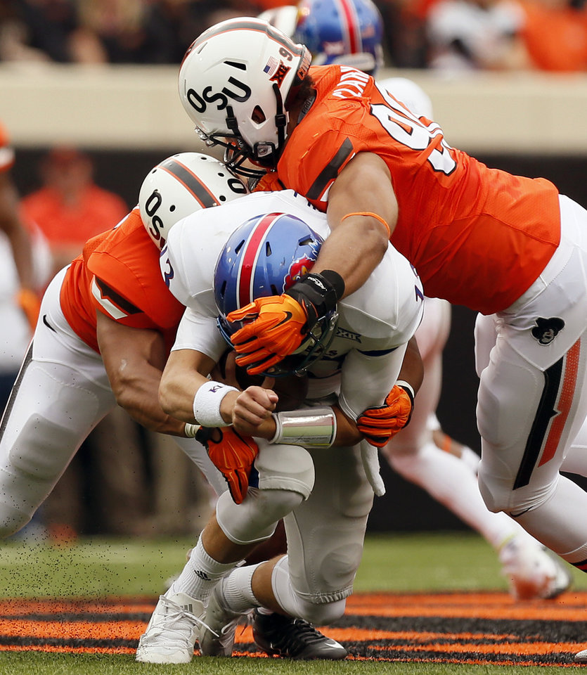 Photo - Oklahoma State's Trace Clark (90), right, and Chad Whitener (45) drop Kansas' Ryan Willis (13) for a loss on a quarterback scramble during a college football game between the Oklahoma State University Cowboys (OSU) and the Kansas Jayhawks (KU) in Stillwater, Okla., Saturday, Oct. 24, 2015. Photo by Nate Billings, The Oklahoman