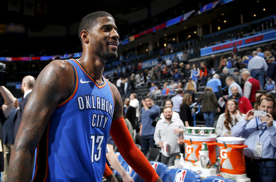Photo - Oklahoma City's Paul George (13) walks of the court following during the NBA game between the Oklahoma City Thunder and the Utah Jazz at the Chesapeake Energy Arena, Saturday, Feb. 23, 2019. Photo by Sarah Phipps, The Oklahoman
