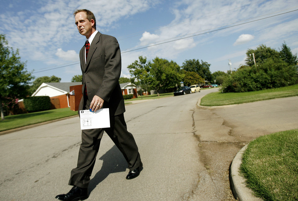 Photo - First Liberty Bank President Joey Root passes out flyers in the Village on Thursday, September, 19, 2007.  By Bryan Terry, The Oklahoman ORG XMIT: KOD