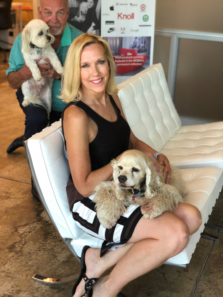 Photo - Commercial interior designer Alison Hafar, co-owner of Spaces Inc. in Edmond, has brought her cocker spaniel Bogey to work since he was a puppy. Her partner, Don Henke, is photo bombing, this shot with his rescue dog Buddy.