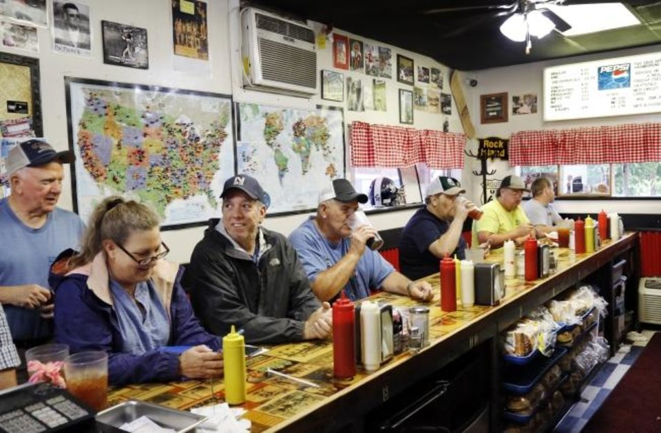 Photo -  Lunch customers sit at the counter inside Sid's Diner on the southwest corner of Choctaw and Wade Street in El Reno on Wednesday. [Jim Beckel/The Oklahoman]