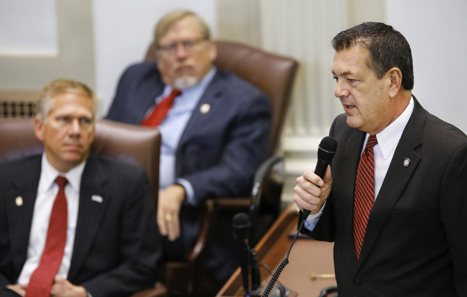 Photo -  Rep. Dan Kirby talks briefly to fellow legislators. State representatives meet for an organizational day in the House chamber on Tuesday, Jan. 3, 2017. Initial discussion focused on the resignation/non-resignation of Rep. Dan Kirby, Tulsa, who has been accused of sexual harassment with a former staff member. [Photo by Jim Beckel, The Oklahoman]