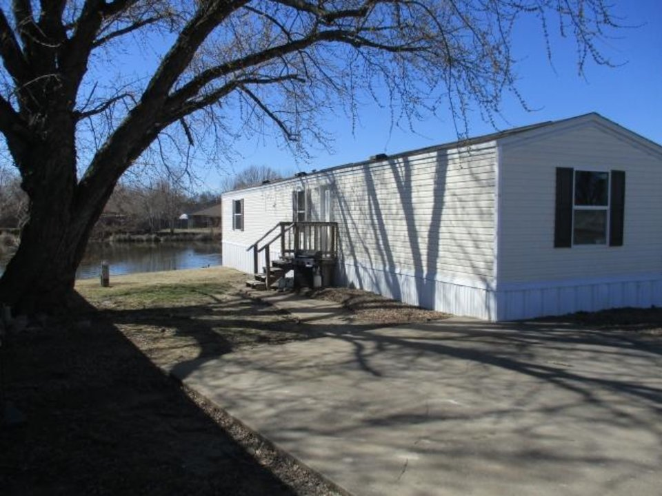 Photo -  A lakeside home is shown at Lakeshore Mobile Home Park in Dewey. [PHOTO PROVIDED]
