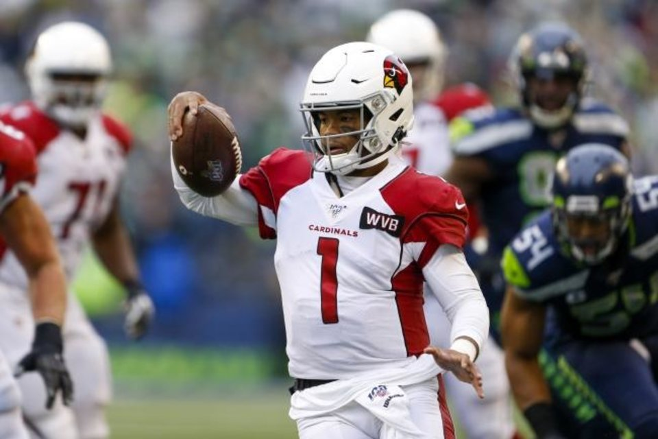 Photo -  Cardinals quarterback Kyler Murray (1) scrambles out of the pocket during Arizona's 27-13 win at Seattle on Sunday. [Joe Nicholson/USA TODAY Sports]