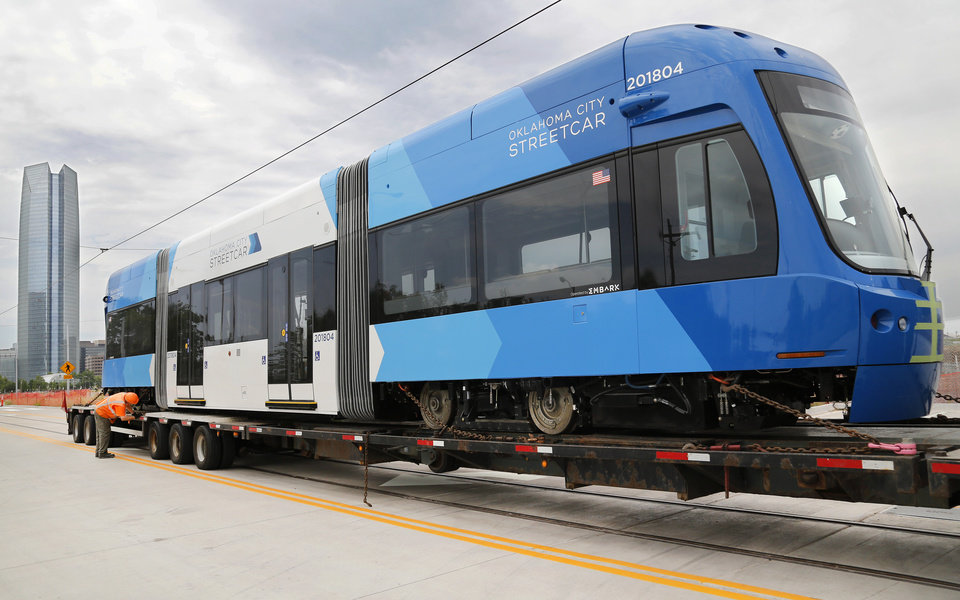Photo -  The fourth of seven Oklahoma City streetcars is delivered Monday to the streetcar barn at SW 7 and Walker. [Photo by Jim Beckel, The Oklahoman]