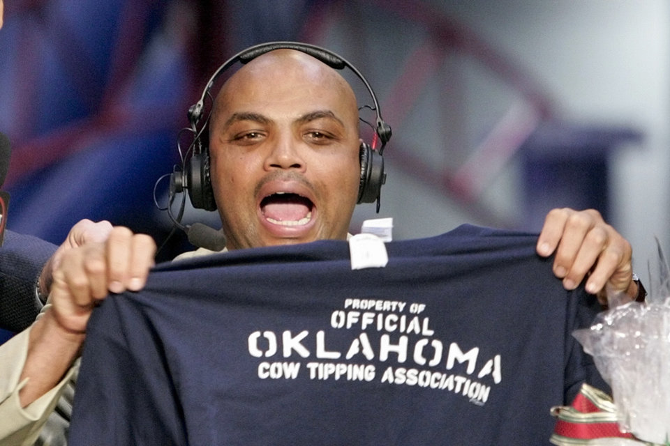 "Photo -  Charles Barkley holds up an ""Oklahoma Cow Tipping Association"" shirt presented to him by KWTV anchor Kelly Ogle and news director Blaise Labbe (cq BLAISE LABBE) on the set of TNT's Inside the NBA at the NBA Jam Session, part of the NBA All-Star events in Houston, Texas, Febraury 16, 2006. Barkley has agreed to take up the challenge of Ogle and Labbe to visit Oklahoma. By Nate Billings, The Oklahoman."