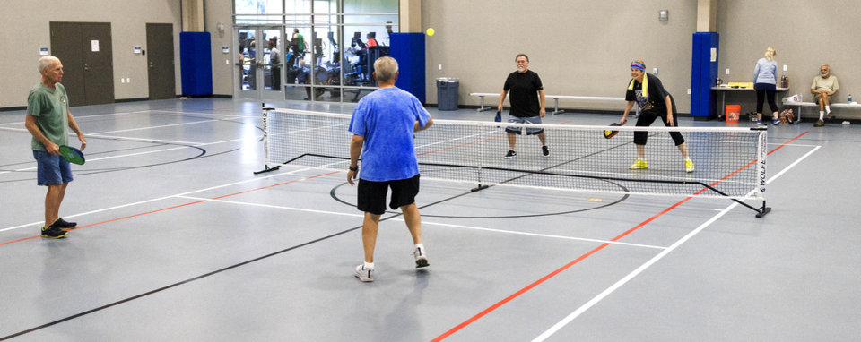 Photo -  Ardith Phares, right, gets some practice in as she plays a game of pickle ball at Healthy Living OKC, 11501 N Rockwell Ave. [PHOTO BY CHRIS LANDSBERGER, THE OKLAHOMAN]