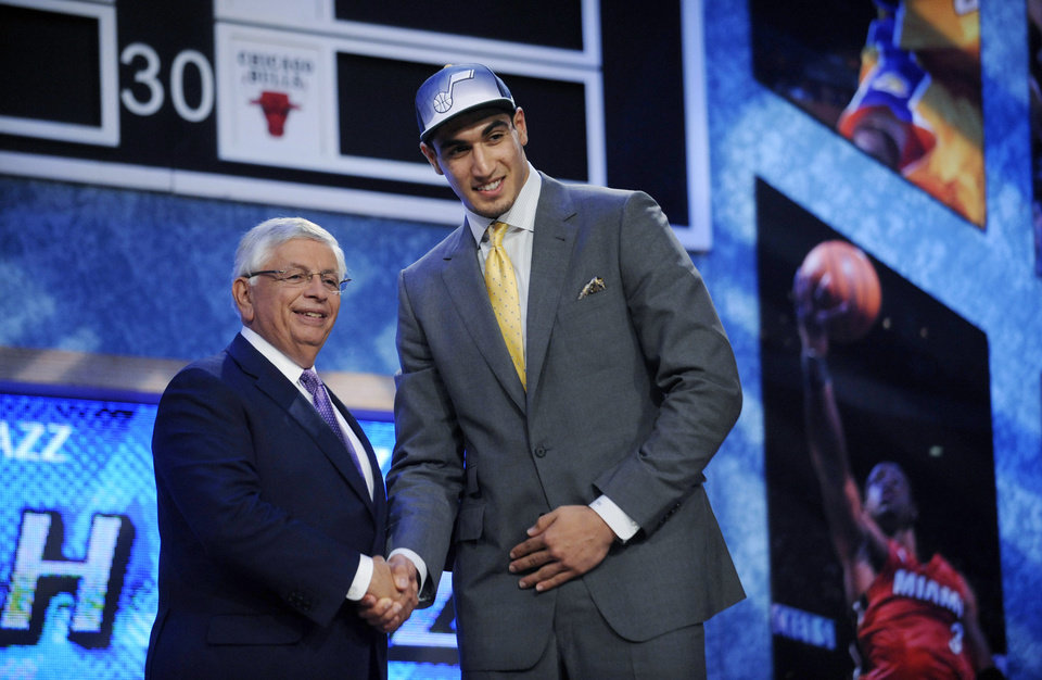 Photo - NBA Commissioner David Stern, left, poses with the No. 3 overall pick, Kentucky's Enes Kanter, from Turkey, who was selected by the Utah Jazz in the NBA draft June 23, 2011, in Newark, N.J. (AP Photo/Bill Kostroun)