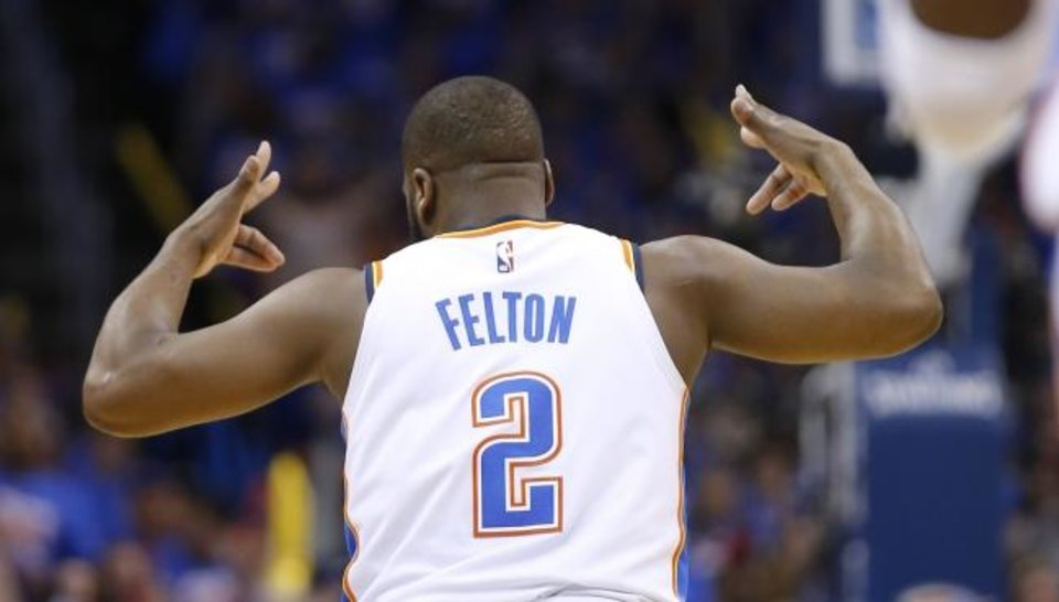 Photo -  Oklahoma City's Raymond Felton (2) reacts after making a 3-point basket in the first half Sunday night against Portland. [Sarah Phipps/The Oklahoman]