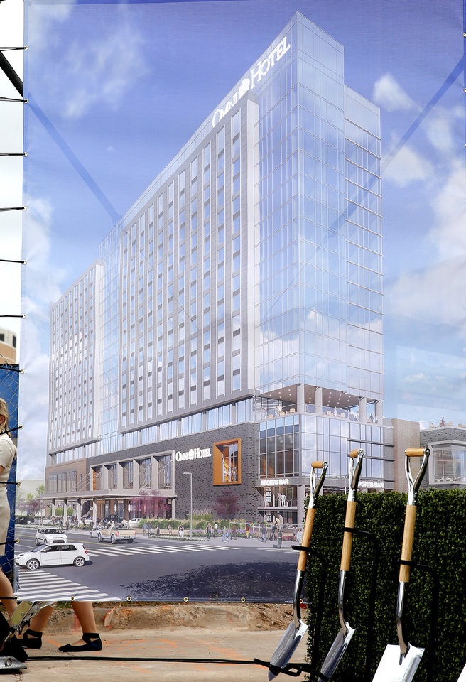 Photo - An artist rendering of the new Omni Hotels & Resorts 17-story, 605 room hotel is seen during a ground breaking ceremony for the new Omni hotel in Oklahoma City, Monday, Oct. 1, 2018. Photo by Bryan Terry, The Oklahoman