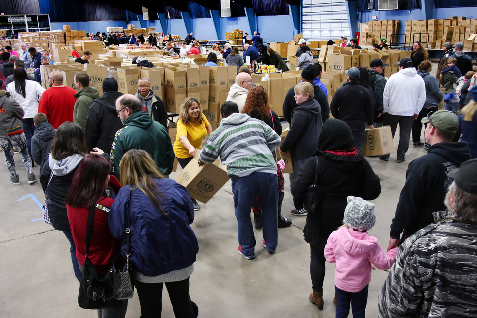 Photo - Free food distribution for federal employees by the Regional Food Bank of Oklahoma at State Fair Park Monday, January 21, 2019.  Photo by Doug Hoke, The Oklahoman
