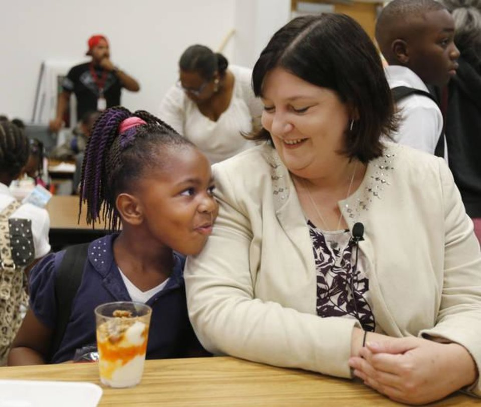 Photo -  Oklahoma City Public Schools Superintendent Aurora Lora talks to Raelysha Fay, 5, on the first day of school at Thelma Parks Elementary in Oklahoma City, Okla., on Aug. 1, 2017. [Photo by Paul Hellstern, The Oklahoman]