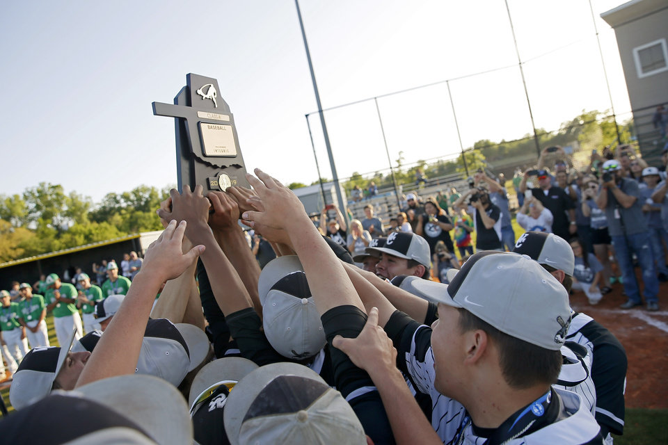 Photo - Wright City celebrates after winning the Class A baseball championship over Rattan at Dolese Park in Oklahoma City,  Saturday, May 4, 2019. [Bryan Terry/The Oklahoman]