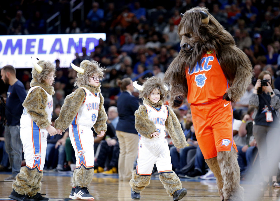 Photo - Rumble entertains the crowd with mini Rumbles during the NBA game between the Oklahoma City Thunder and the Milwaukee Bucks at Chesapeake Energy Arena,   Sunday, Nov. 10, 2019.  [Sarah Phipps/The Oklahoman]