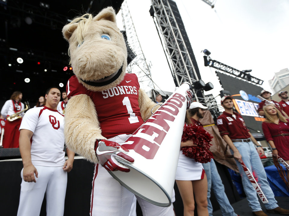 Photo - Oklahoma mascot Boomer entertains the crowd during a pep rally for the University of Oklahoma in New Orleans, Sunday, Jan. 1, 2017. The University of Oklahoma football team will play Auburn in the Allstate Sugar Bowl on Monday, Jan. 2. Photo by Sarah Phipps, The Oklahoman