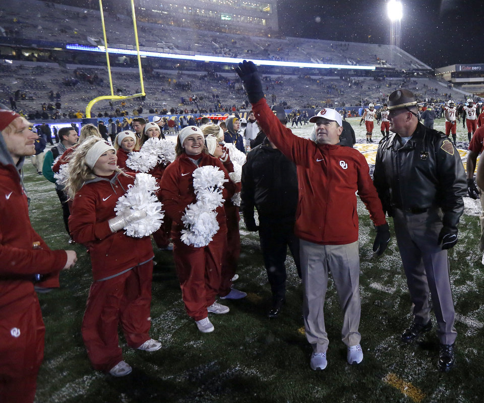 Photo -  OU coach Bob Stoops waves to fans after the Sooners' 56-28 rout of West Virginia on Saturday night in Morgantown, W.Va. [PHOTO BY BRYAN TERRY, THE OKLAHOMAN]