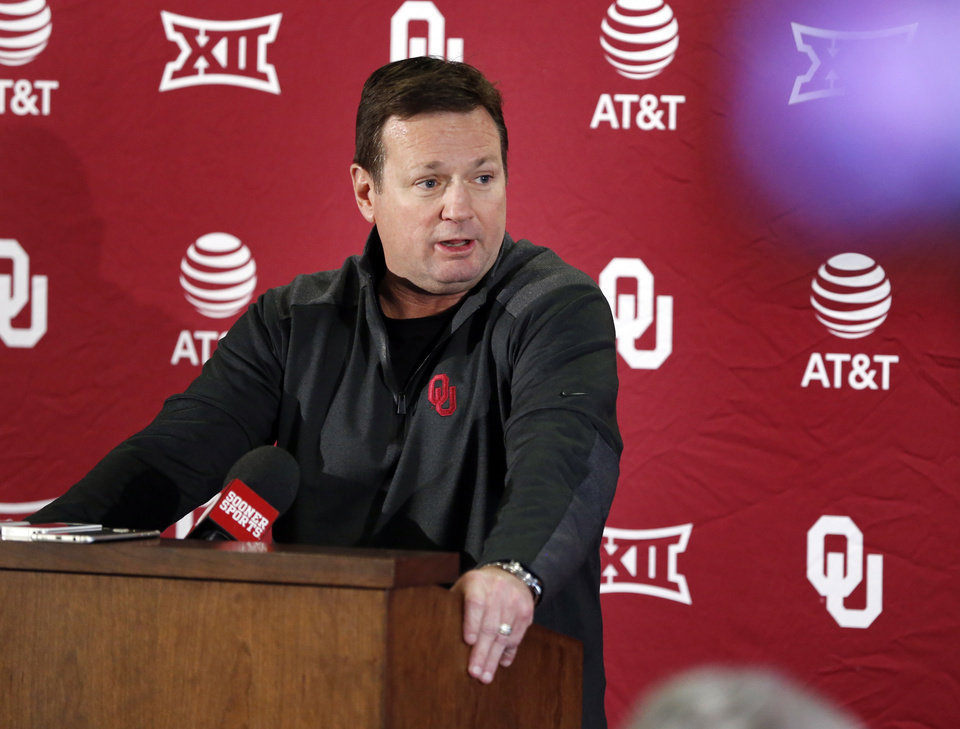 Photo -  Oklahoma coach Bob Stoops spent the day before national signing day on the phone with dozens of recruits for the 2018 and 2019 classes. [PHOTO BY STEVE SISNEY, The Oklahoman]