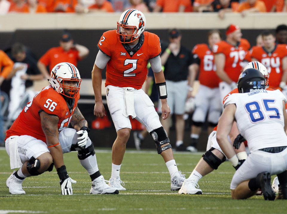 Photo -  Oklahoma State offensive lineman Larry Williams (56) listens to quarterback Mason Rudolph (2) call an audible during a 2017 game against Tulsa. It was one of only three games Williams played before a broken ankle ended his season. [PHOTO BY NATE BILLINGS, THE OKLAHOMAN]