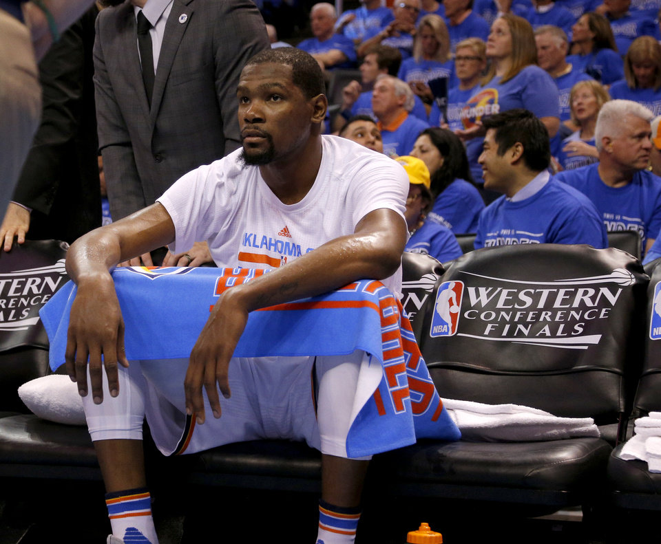 Photo - Oklahoma City's Kevin Durant (35) sit on the bench during a time out during Game 6 of the Western Conference finals in the NBA playoffs between the Oklahoma City Thunder and the Golden State Warriors at Chesapeake Energy Arena in Oklahoma City, Saturday, May 28, 2016. Photo by Sarah Phipps, The Oklahoman