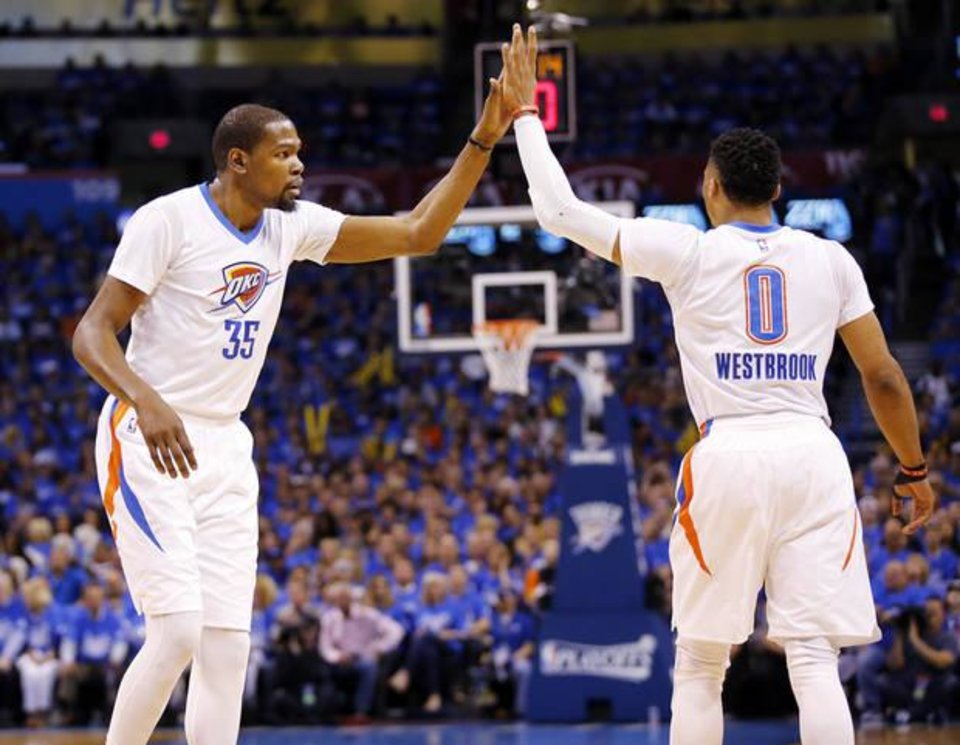 Photo - Kevin Durant and Russell Westbrook celebrate a play in the first half of Game 5 Monday night. (Photo by Nate Billings)