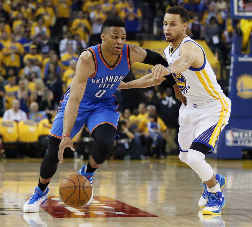 Photo - Oklahoma City's Russell Westbrook (0) goes past Golden State's Stephen Curry (30) during Game 5 of the Western Conference finals in the NBA playoffs between the Oklahoma City Thunder and the Golden State Warriors at Oracle Arena in Oakland, Calif., Thursday, May 26, 2016. Photo by Nate Billings, The Oklahoman