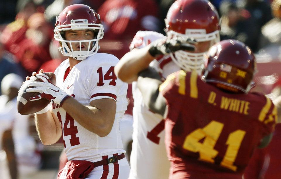Photo -  Oklahoma's Cody Thomas (14) looks to pass during a college football game between the University of Oklahoma Sooners (OU) and the Iowa State Cyclones (ISU) at Jack Trice Stadium in Ames, Iowa, Saturday, Nov. 1, 2014. Photo by Nate Billings, The Oklahoman