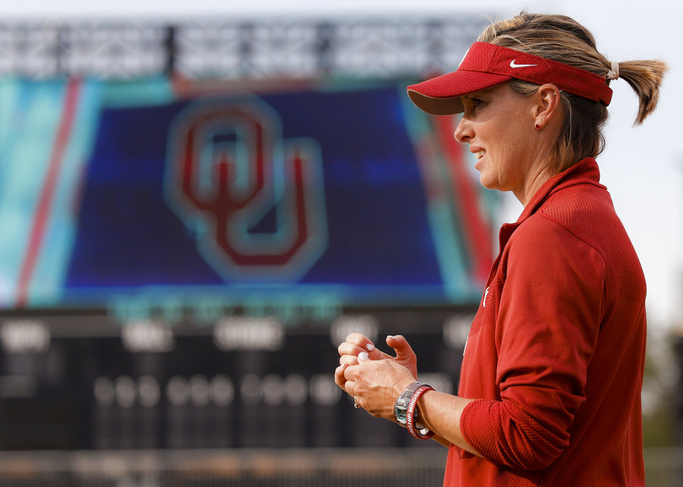Photo -  OU pitching coach Melyssa Lombardi watches the Sooners during practice for the Women's College World Series at Hall of Fame Stadium in Oklahoma City on Wednesday. [PHOTO BY CHRIS LANDSBERGER, THE OKLAHOMAN]
